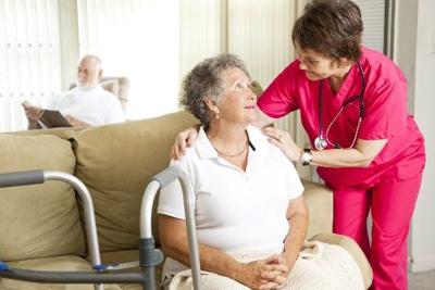 Nurse checking up on an elderly woman