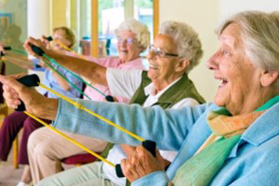 Seniors exercising with stretch bands