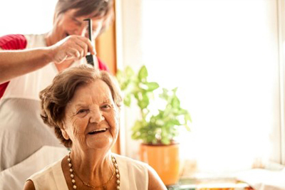Older woman getting a hair cut